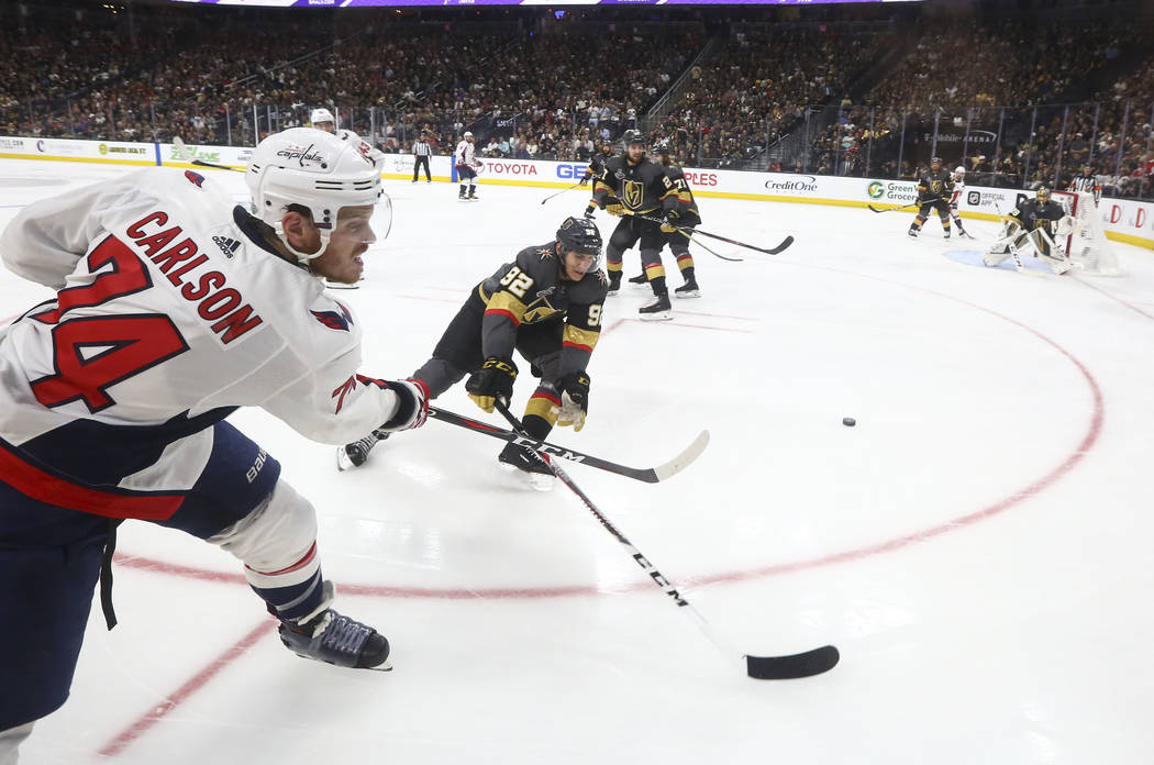 Washington Capitals defenseman John Carlson (74) shoots past Golden Knights left wing Tomas Nosek (92) during the second period of Game 1 of the NHL hockey Stanley Cup Final at the T-Mobile Arena ...