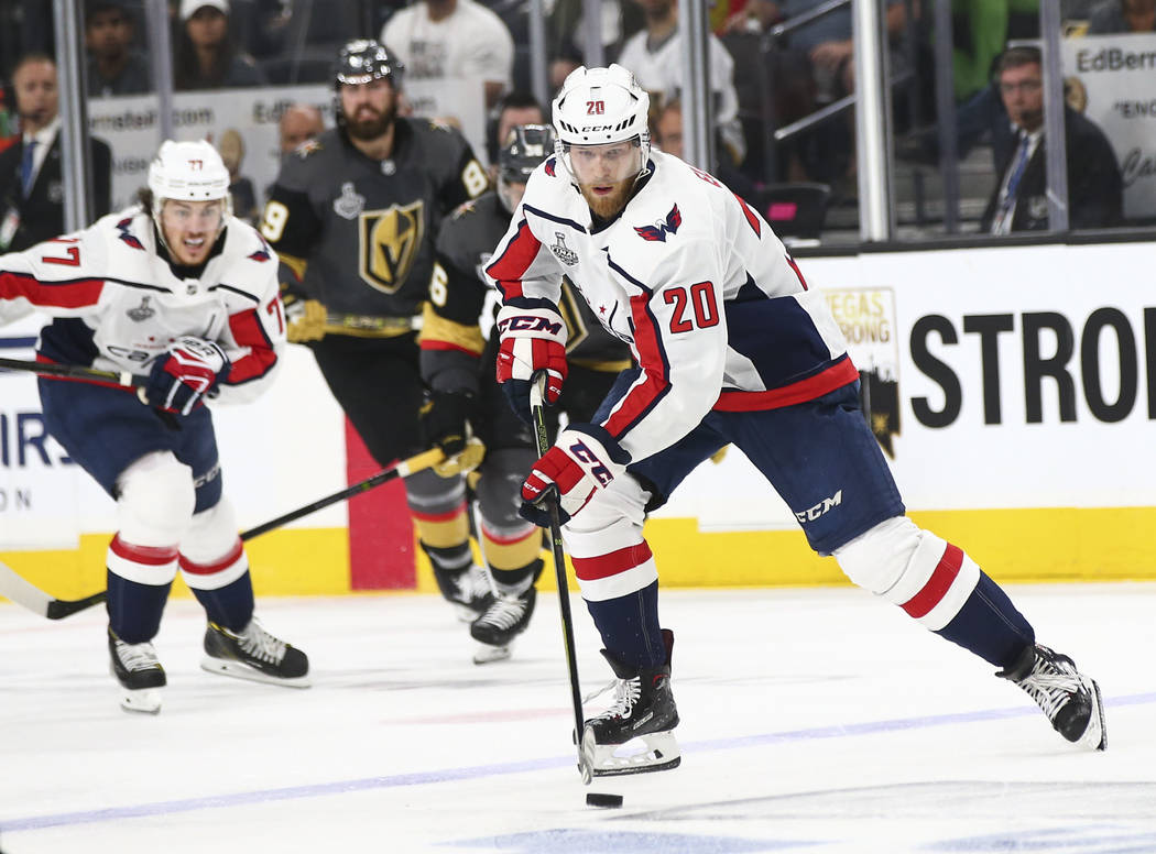 Washington Capitals center Lars Eller (20) moves the puck against the Golden Knights during the second period of Game 1 of the NHL hockey Stanley Cup Final at the T-Mobile Arena in Las Vegas on Mo ...