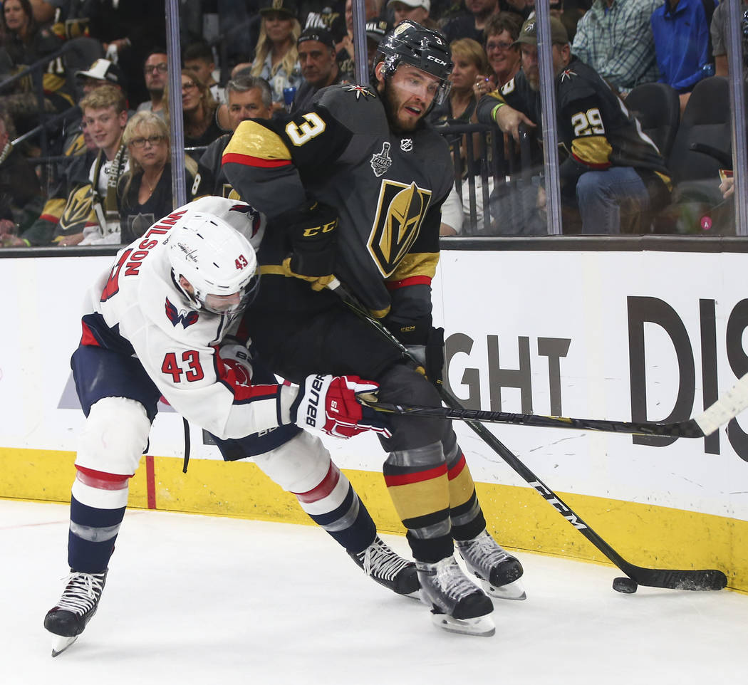 Golden Knights defenseman Brayden McNabb (3) controls the puck against Washington Capitals right wing Tom Wilson (43) during the second period of Game 1 of the NHL hockey Stanley Cup Final at the ...