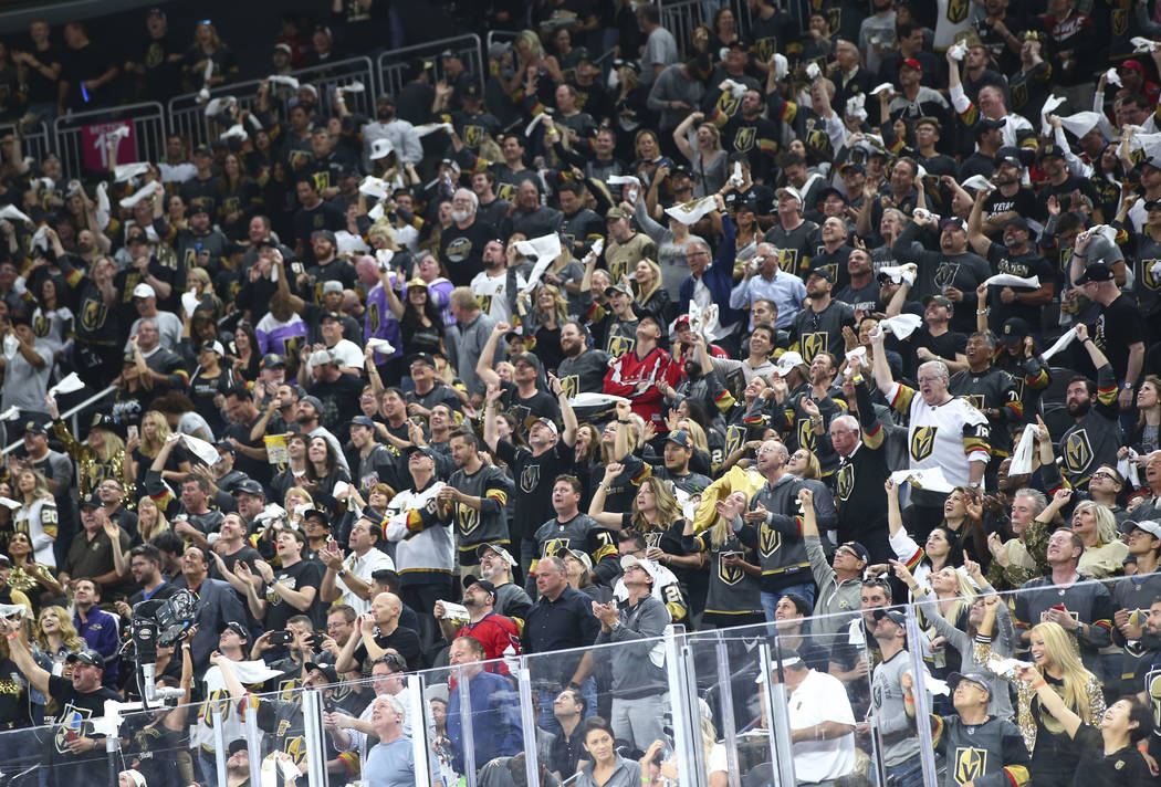 Golden Knights fans celebrate a goal by Golden Knights right wing Reilly Smith, not pictured, during the second period of Game 1 of the NHL hockey Stanley Cup Final against the Washington Capitals ...