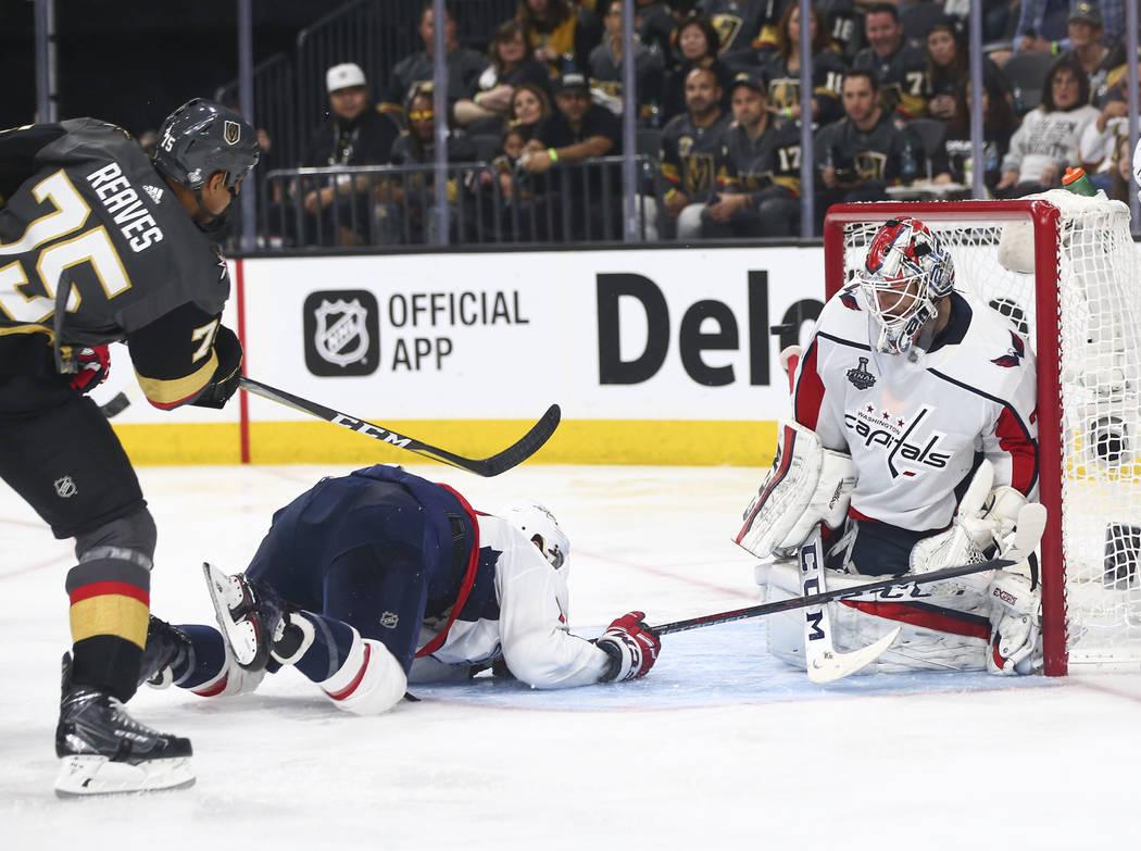 Golden Knights right wing Ryan Reaves (75) scores past Washington Capitals goaltender Braden Holtby (70) during the third period of Game 1 of the NHL hockey Stanley Cup Final at the T-Mobile Arena ...