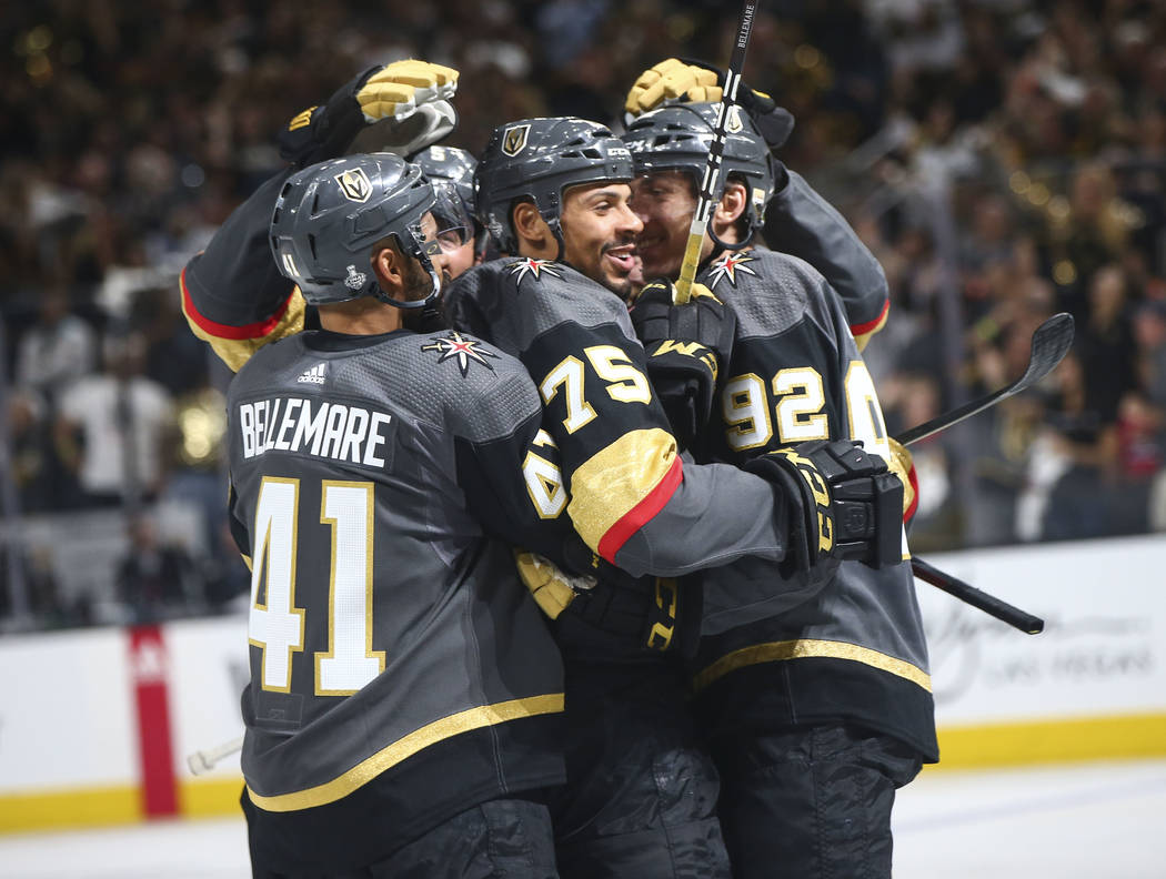 Golden Knights right wing Ryan Reaves (75) celebreates his goal against the Washington Capitals with left wing Pierre-Edouard Bellemare (41) during the third period of Game 1 of the NHL hockey Sta ...