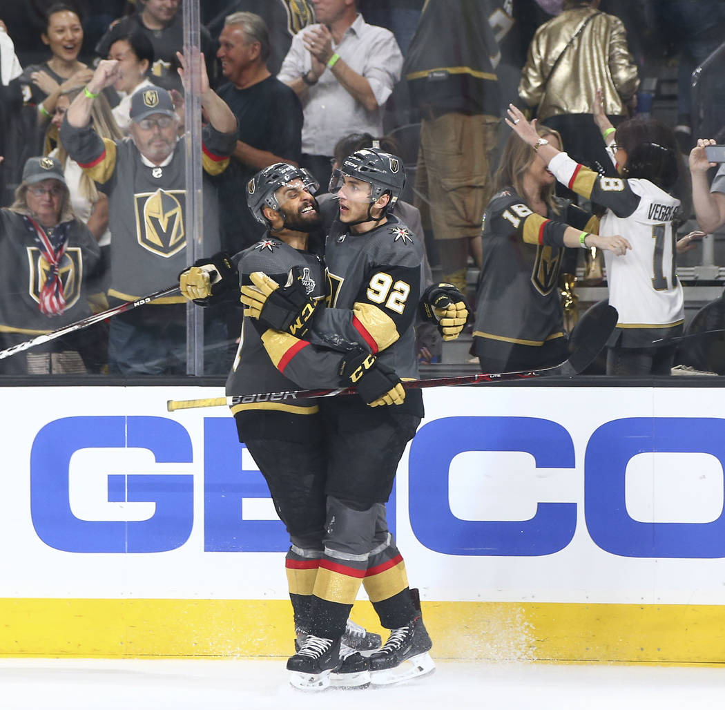 Golden Knights left wing Tomas Nosek (92) celebrates his empty net goal against the Washington Capitals with Golden Knights left wing Pierre-Edouard Bellemare during the third period of Game 1 of ...