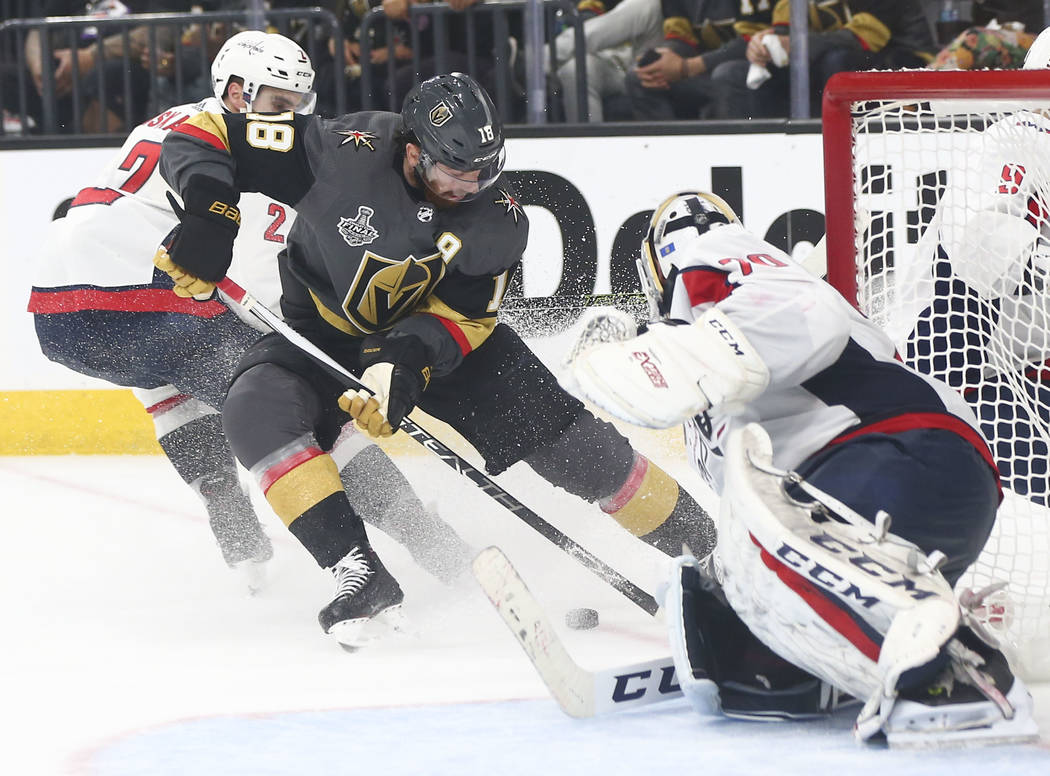 Golden Knights left wing James Neal (18) moves the puck around the net as Washington Capitals goaltender Braden Holtby (70) defends during the third period of Game 1 of the NHL hockey Stanley Cup ...