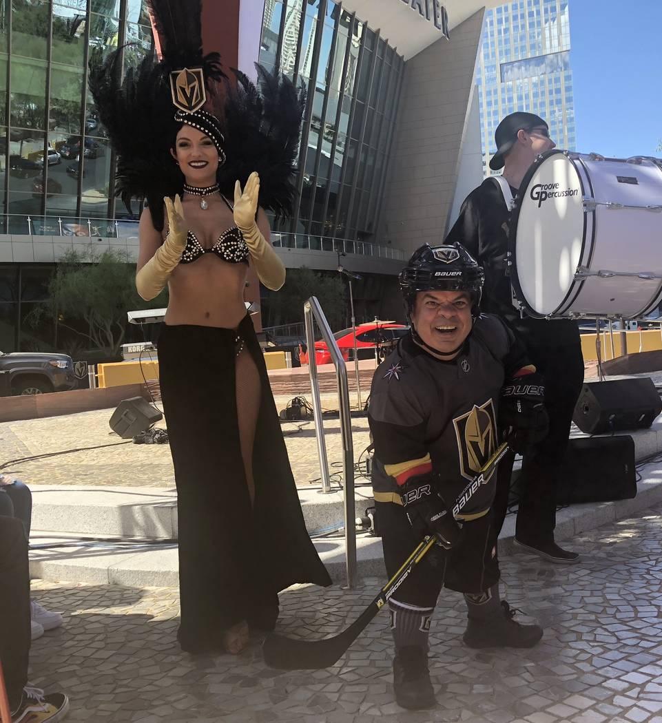 "Rachel Swindler, co-star of ""Tony n' Tina's Wedding"" at Bally's, is shown with Brian Thomas, who portrays Lucky the Leprechaun at O'Shea's, at the Park promenade on Monday, May 28, 2018. (John Kat ..."