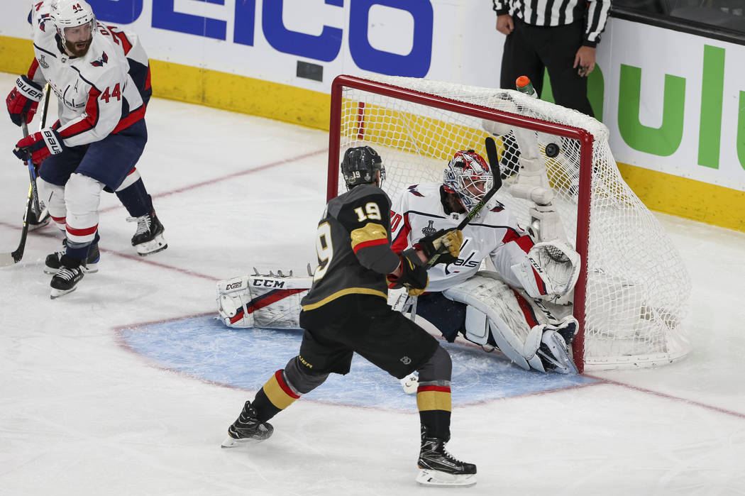Vegas Golden Knights right wing Reilly Smith (19) scores against Washington Capitals goaltender Braden Holtby (70) during the second period in Game 1 of the NHL hockey Stanley Cup Finals between t ...