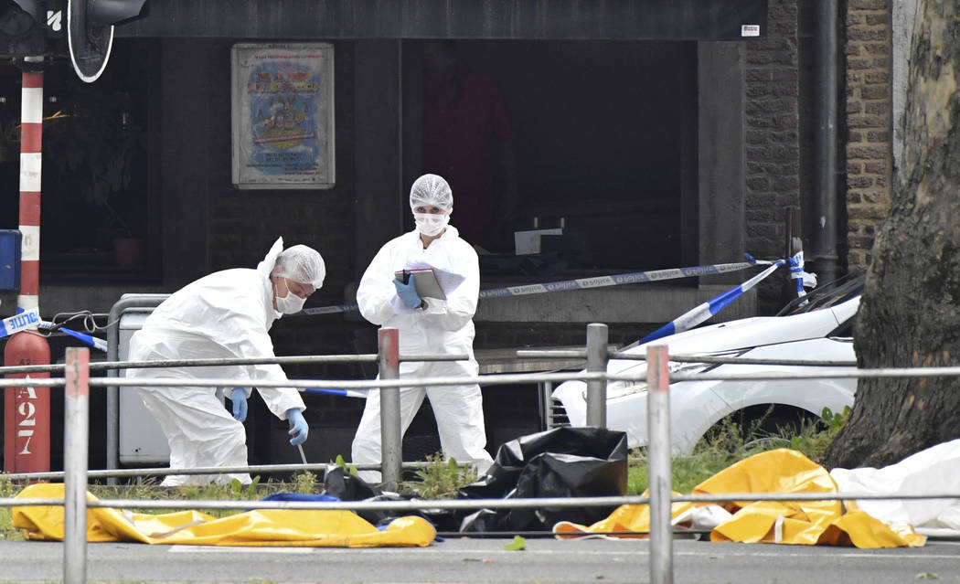 Police investigate at the scene of a shooting in Liege, Belgium, Tuesday, May 29, 2018. A gunman killed three people, including two police officers, in the Belgian city of Liege on Tuesday, a city ...