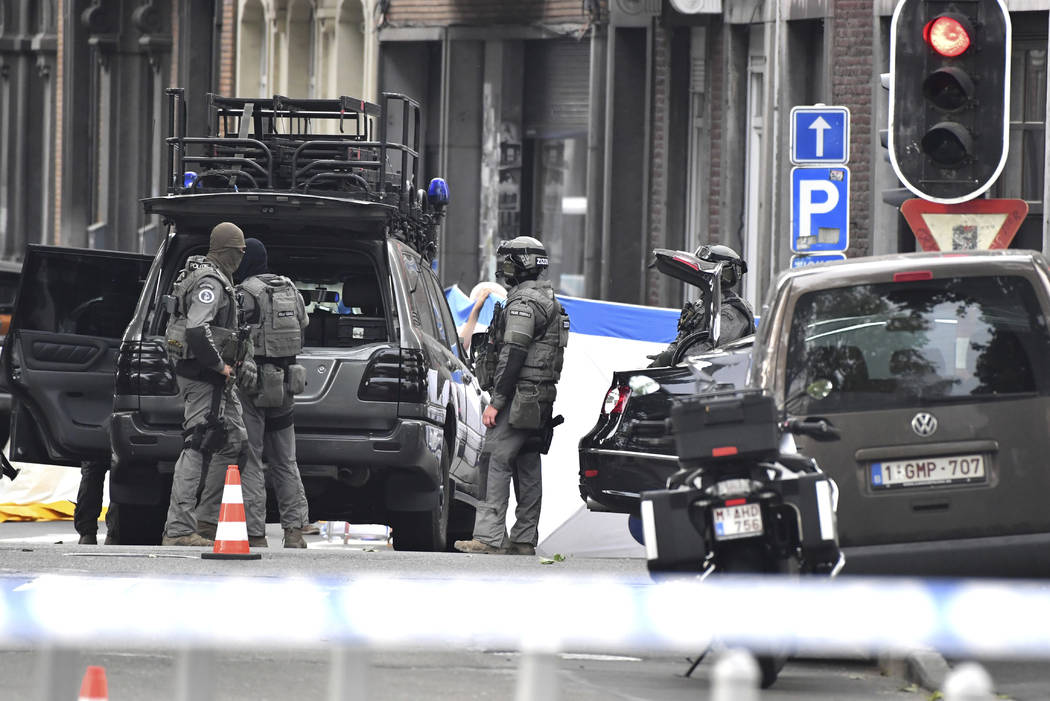 Belgian Special Police at the scene of a shooting in Liege, Belgium, Tuesday, May 29, 2018. A gunman killed three people, including two police officers, in the Belgian city of Liege on Tuesday, a ...