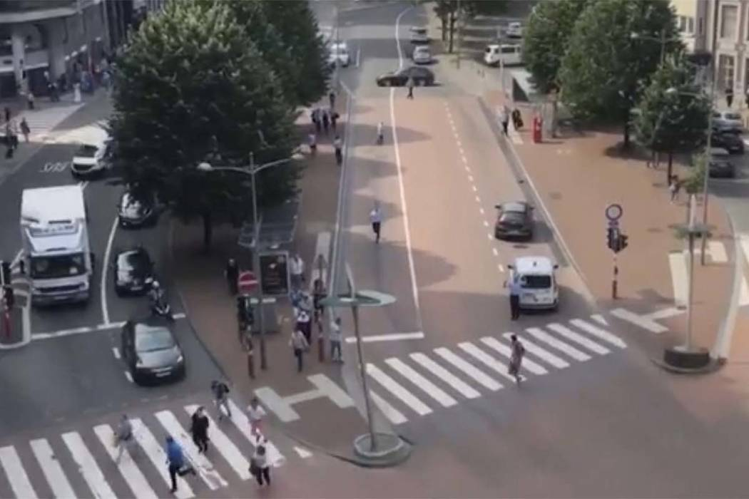 In this grab taking from video Tuesday, May 29, 2018, people run in the street after hearing gun shots, in Liege, Belgium. A gunman killed three people, including two police officers, in the Belgi ...