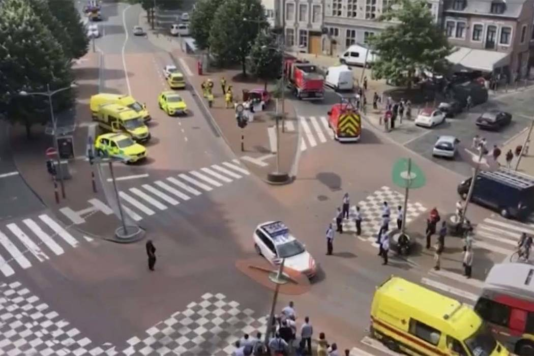 In this grab taking from video Tuesday, May 29, 2018,emergency services arrive at the scene after a shooting incident, in Liege, Belgium. (Victor Jay via AP)