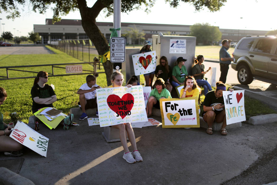 Santa Fe High School supporters gather by the school to wish student and staff well on their first day of classes Tuesday, May 29, 2018 after a shooting that killed 10 people, in Santa Fe, Texas. ...