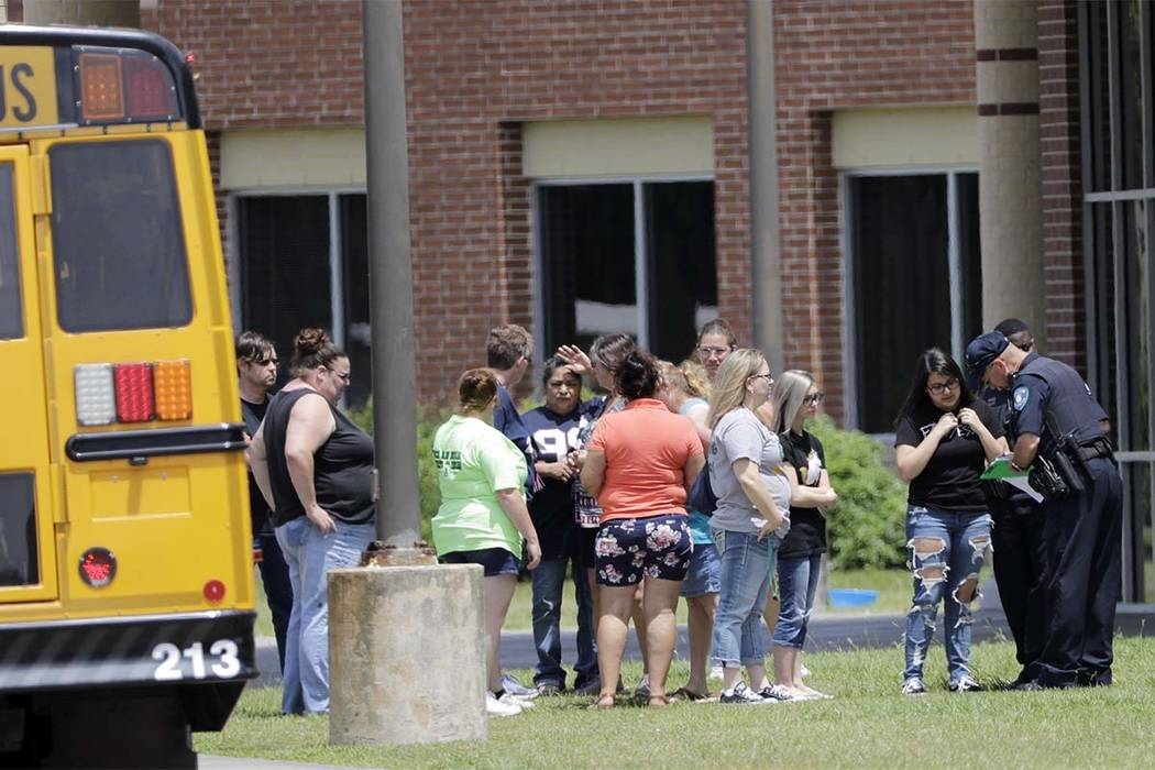 Students are checked before entering Santa Fe High School in Santa Fe, Texas, on Saturday, May 19, 2018. Students and teachers were allowed back into parts of the school to retrieve their belongin ...