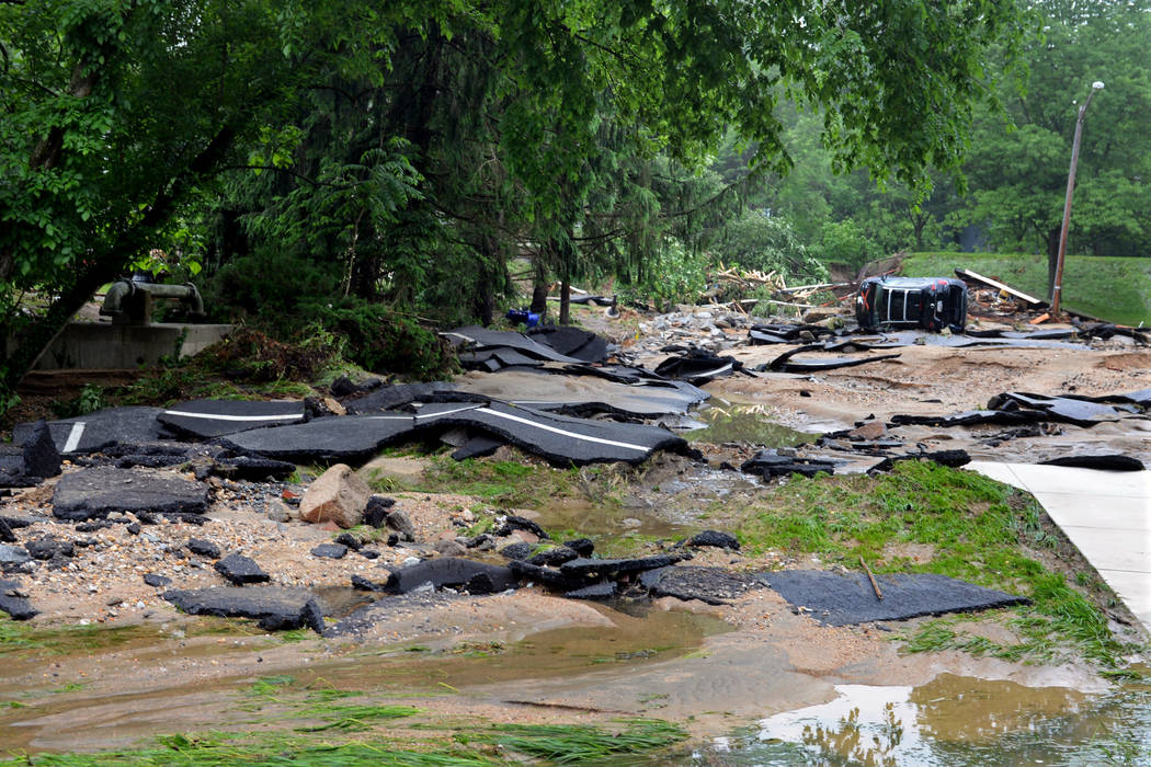 Destroyed chunks of roadway rest after being washed into a riverbed just off Main Street in flood-ravaged Ellicott City, Md., Monday, May 28, 2018. Sunday's destructive flooding left the former mi ...