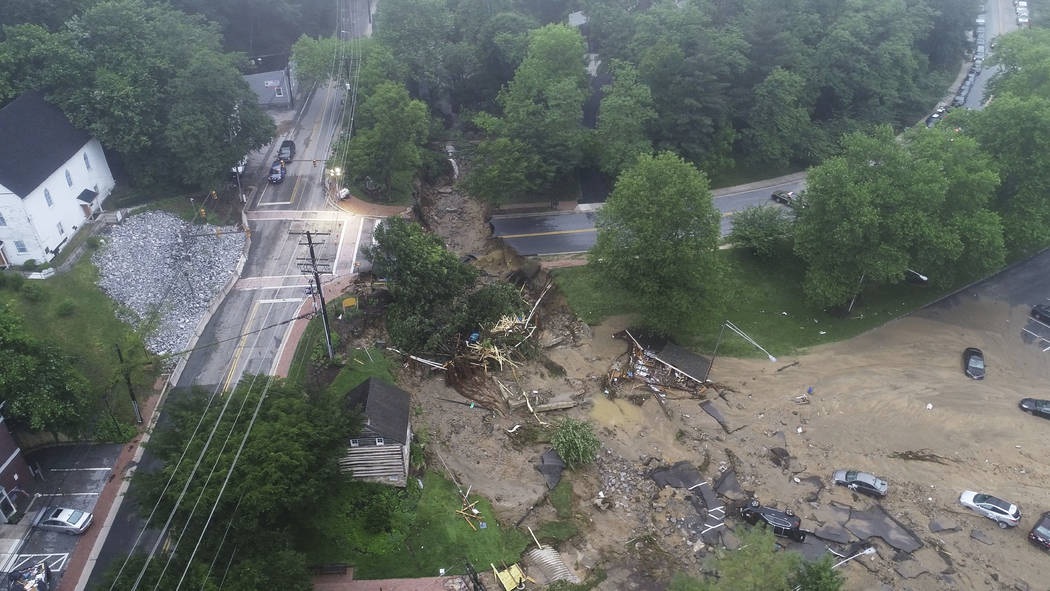 This image made from video provided by DroneBase shows damage by floodwaters near the intersection of Ellicott Mills Drive and Main Street in Ellicott City, Md., Monday, May 28, 2018. Howard Count ...