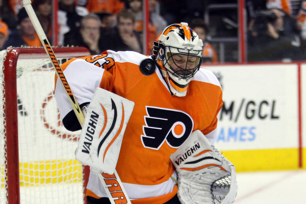 Philadelphia Flyers goalie Brian Boucher reacts as the puck speeds past in the third period of an NHL hockey game with the Pittsburgh Penguins, Thursday, March 7, 2013, in Philadelphia. The Pengui ...