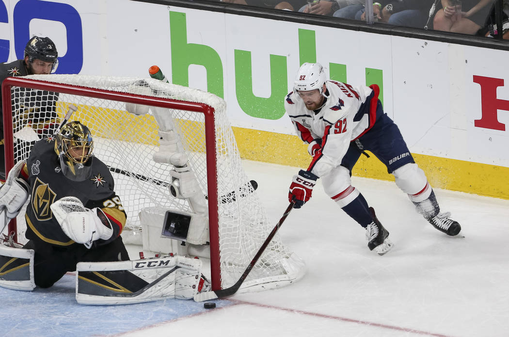 Vegas Golden Knights goaltender Marc-Andre Fleury (29) blocks a wrap around attempt by Washington Capitals center Evgeny Kuznetsov (92) during the third period in Game 1 of the NHL hockey Stanley ...