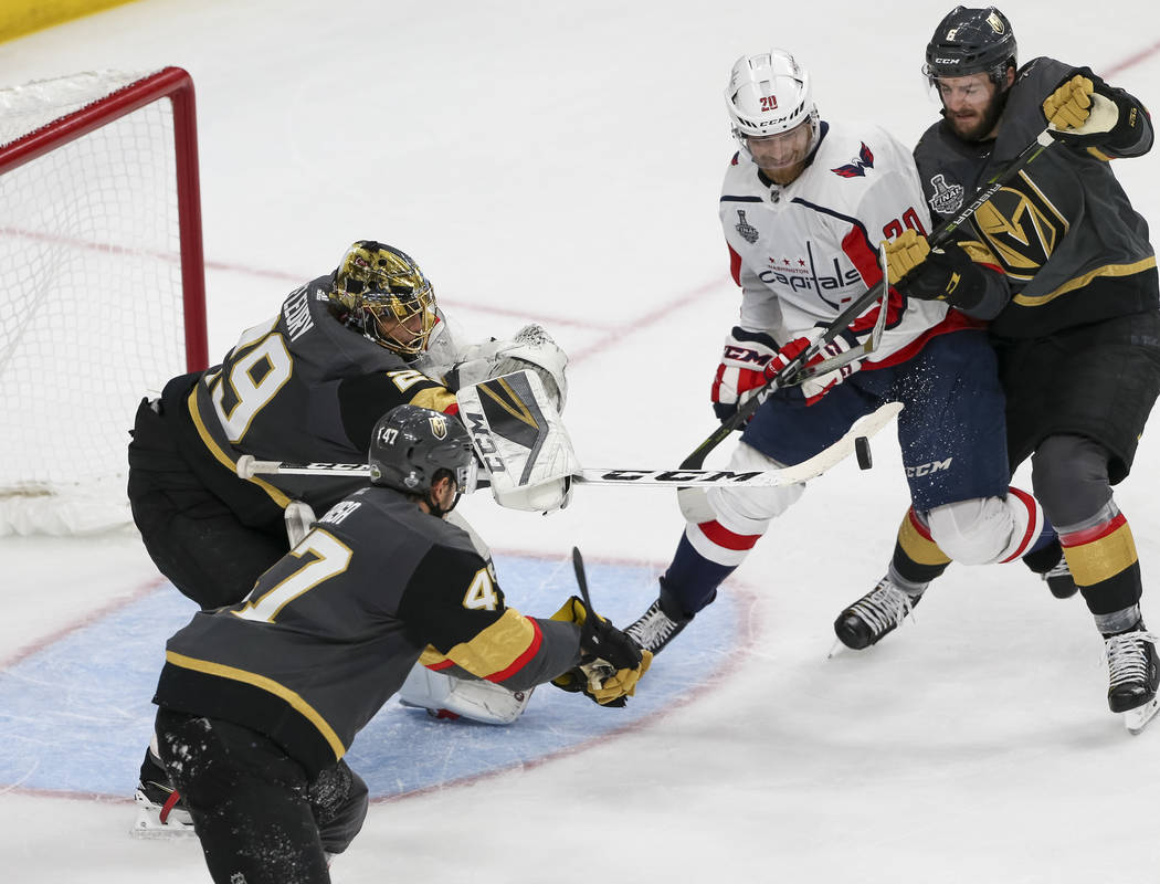 Vegas Golden Knights goaltender Marc-Andre Fleury (29) deflects the puck as Washington Capitals center Lars Eller (20) looks for the rebounds during the third period in Game 1 of the NHL hockey St ...
