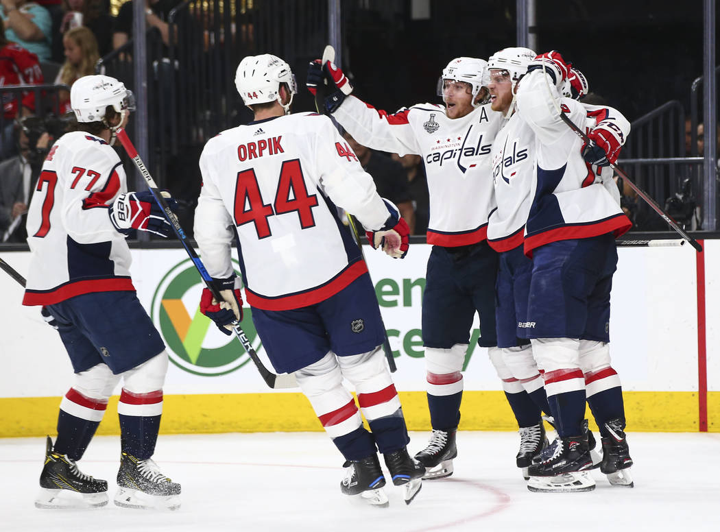 Washington Capitals players celebrate a goal against the Golden Knights during the second period of Game 1 of the NHL hockey Stanley Cup Final at the T-Mobile Arena in Las Vegas on Monday, May 28, ...