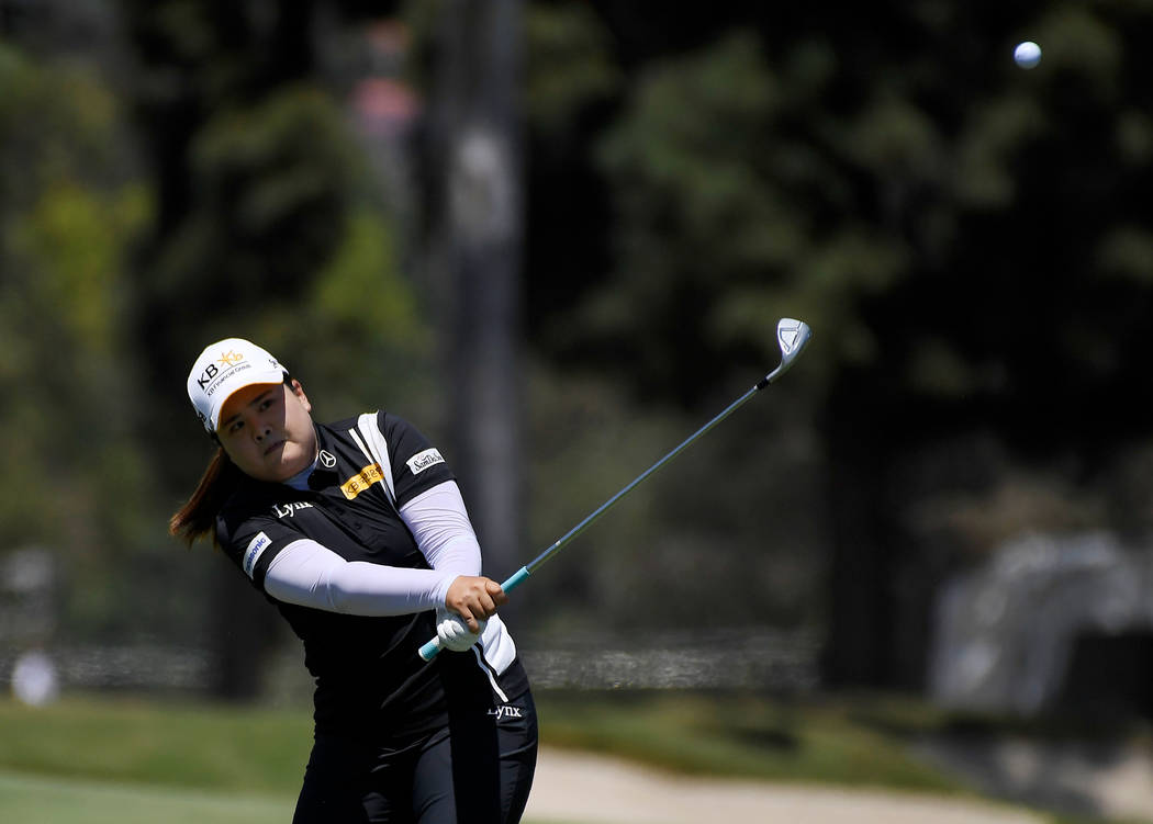 Inbee Park, of South Korea, hits from the fairway on the second hole during the third round of the LPGA Tour's HUGEL-JTBC LA Open golf tournament at Wilshire Country Club on Saturday, April 21, 20 ...