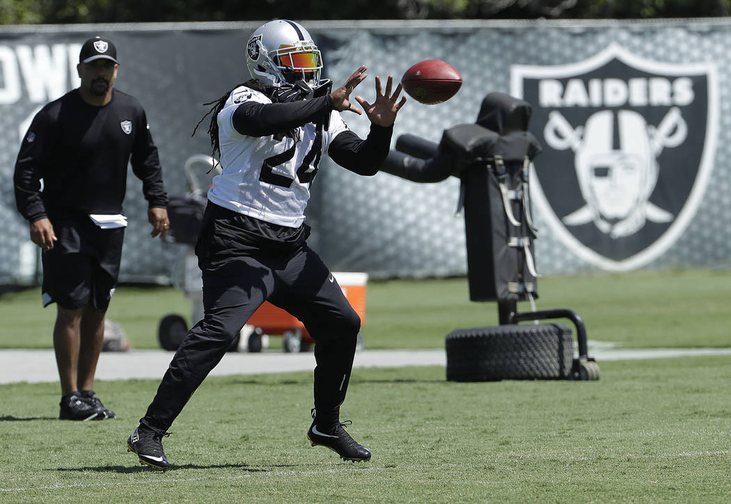 Oakland Raiders running back Marshawn Lynch catches a pass during practice at the team's NFL football training facility in Alameda, Calif., Tuesday, May 29, 2018. (AP Photo/Jeff Chiu)