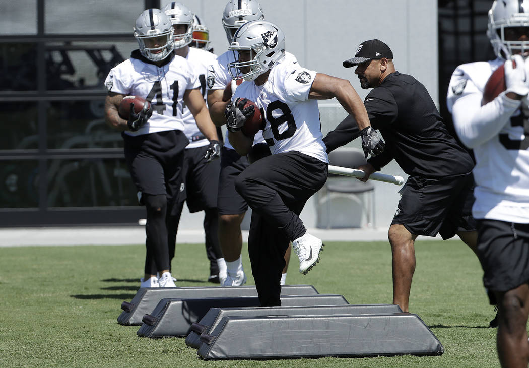 Oakland Raiders running back Doug Martin practices at the team's NFL football training facility in Alameda, Calif., Tuesday, May 29, 2018. (AP Photo/Jeff Chiu)