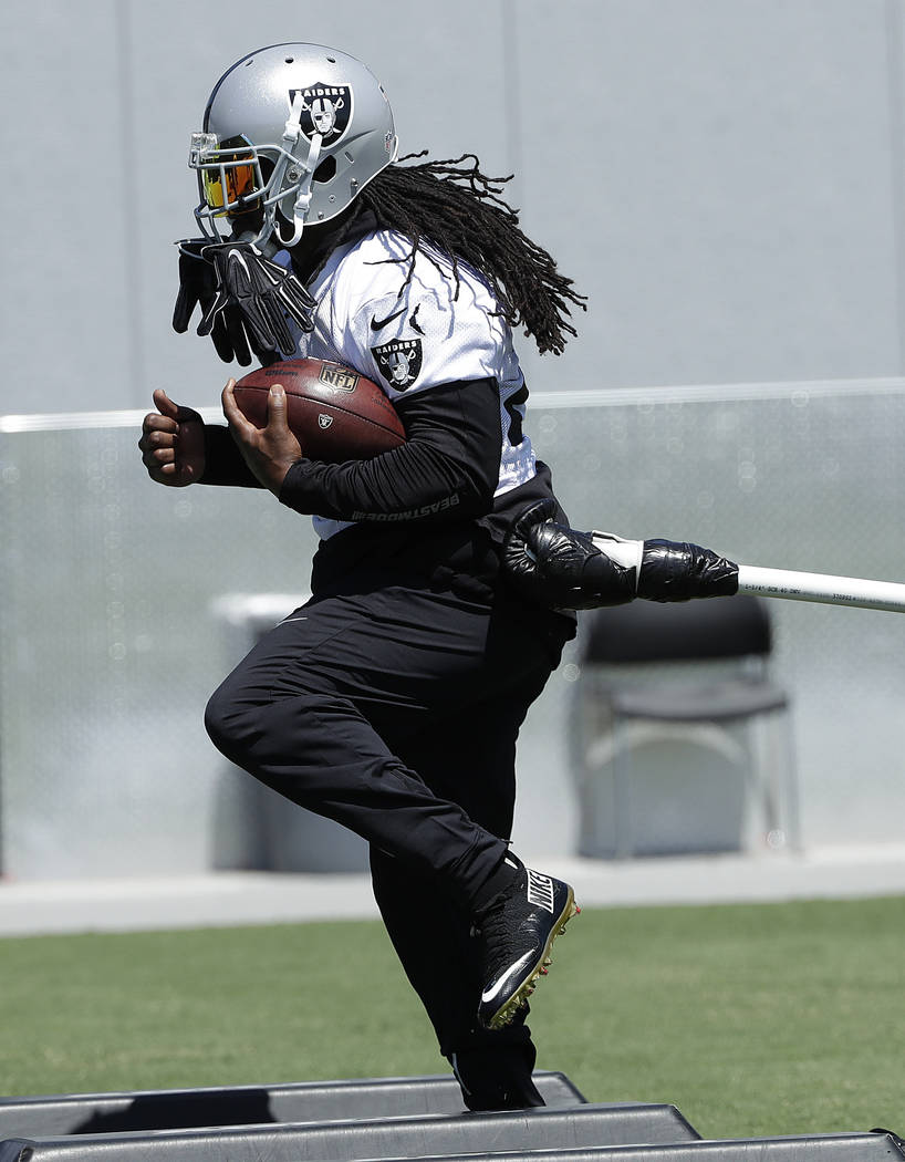 Oakland Raiders running back Marshawn Lynch practices at the team's NFL football training facility in Alameda, Calif., Tuesday, May 29, 2018. (AP Photo/Jeff Chiu)