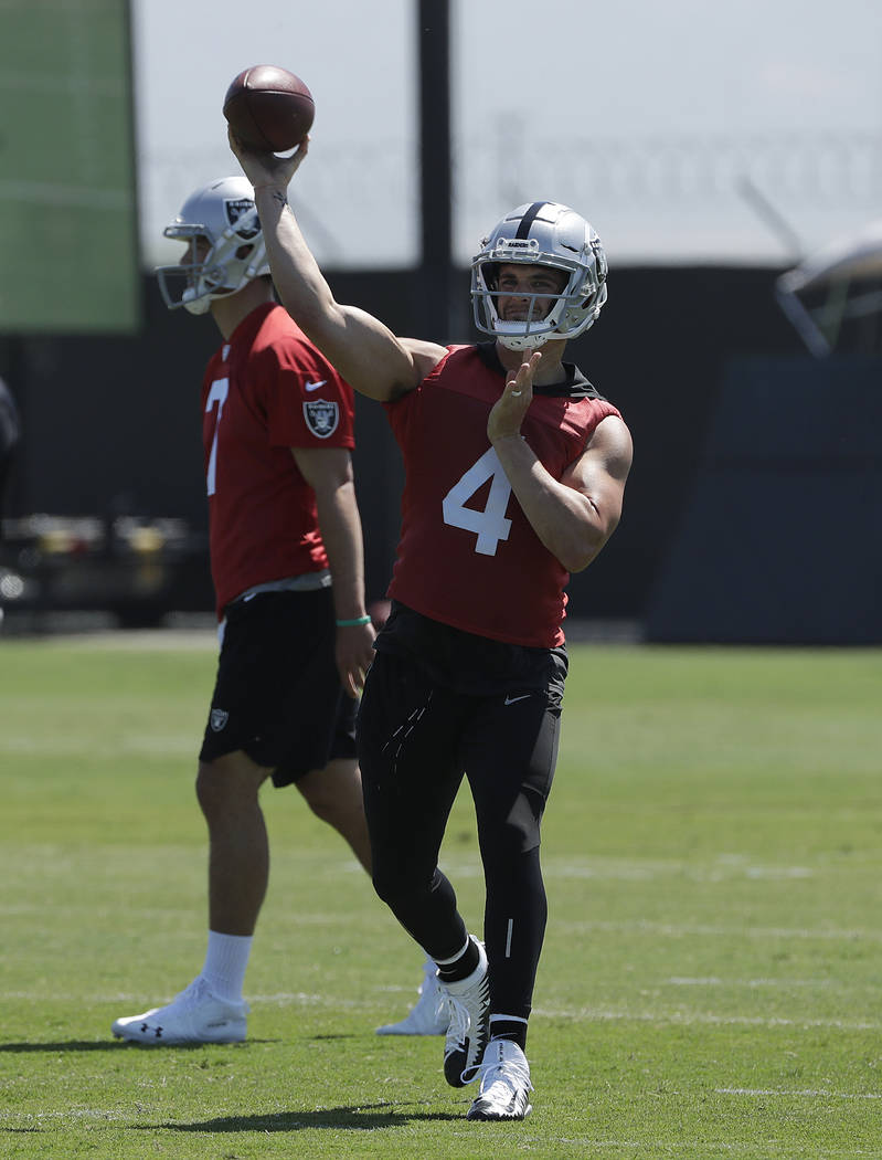 Oakland Raiders quarterback Derek Carr passes during practice at the team's NFL football training facility in Alameda, Calif., Tuesday, May 29, 2018. (AP Photo/Jeff Chiu)