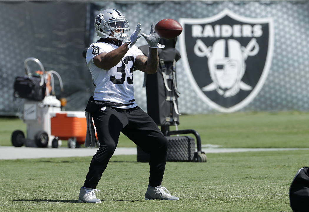 Oakland Raiders running back DeAndre Washington catches a pass during practice at the team's NFL football training facility in Alameda, Calif., Tuesday, May 29, 2018. (AP Photo/Jeff Chiu)