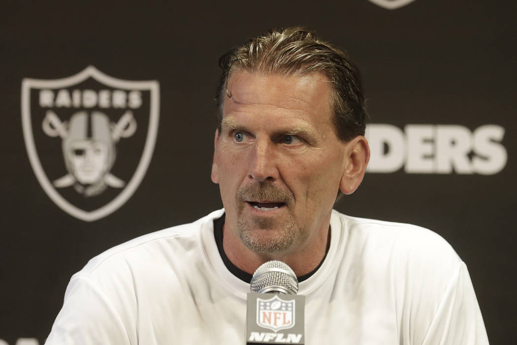 Oakland Raiders offensive coordinator Greg Olson speaks to reporters at the team's NFL football training facility in Alameda, Calif., Tuesday, May 29, 2018. (AP Photo/Jeff Chiu)