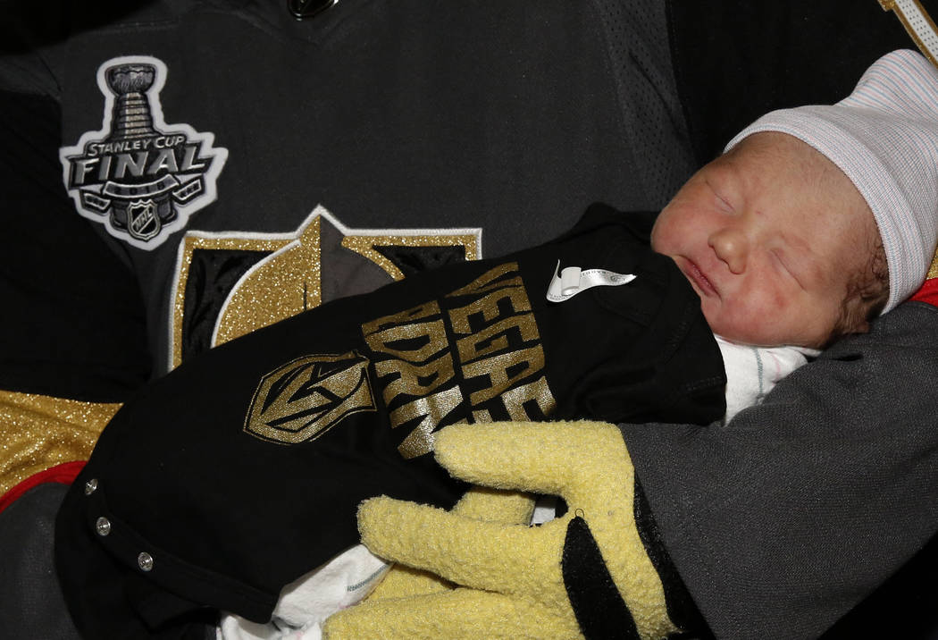 Golden Knights mascot Chance cradles two-day-old Boadie Morgan after delivering Vegas Born onesies to almost 100 newborns at Summerlin Hospital on Tuesday, May 29, 2018, in Las Vegas. Bizuayehu Te ...