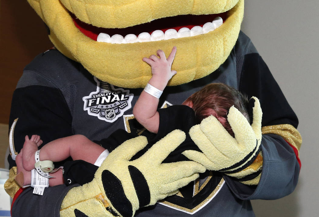 Golden Knights mascot Chance cradles one-day-old Leila Rose after delivering her Vegas Born onesies to almost 100 newborns at Summerlin Hospital on Tuesday, May 29, 2018, in Las Vegas. Bizuayehu T ...