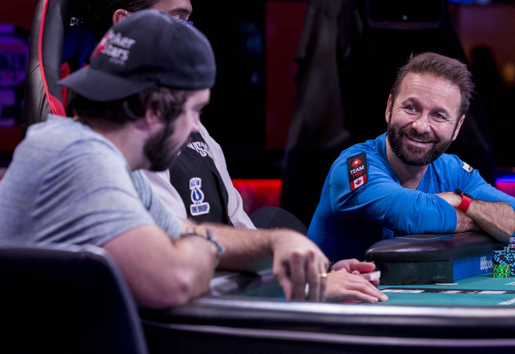 Daniel Negreanu, right, looks at his opponent Jason Mercier across the table during the World Series of Poker $10,000 no-limit hold 'em Main Event at the Rio Convention Center in Las Vegas, Monda ...