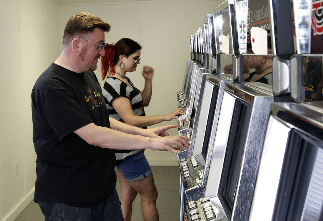 Andy Martello of Las Vegas and Liz Vestal of Nashville, Tenn., play a slot machine inside a trailer on the Moulin Rouge site on Tuesday, May 29, 2018, in Las Vegas. Representatives of the trust th ...