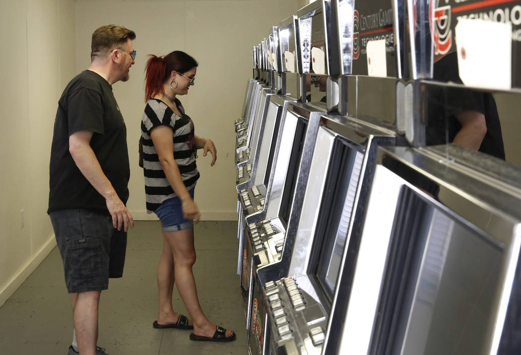 lAndy Martello of Las Vegas and Liz Vestal of Nashville, Tenn., play a slot machine inside a trailer on the Moulin Rouge site on Tuesday, May 29, 2018, in Las Vegas. Representatives of the trust t ...