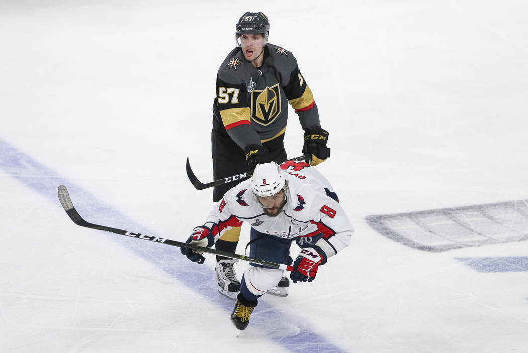 Vegas Golden Knights left wing David Perron (57) cross checks Washington Capitals left wing Alex Ovechkin (8) during the third period in Game 1 of the NHL hockey Stanley Cup Finals at T-Mobile Are ...