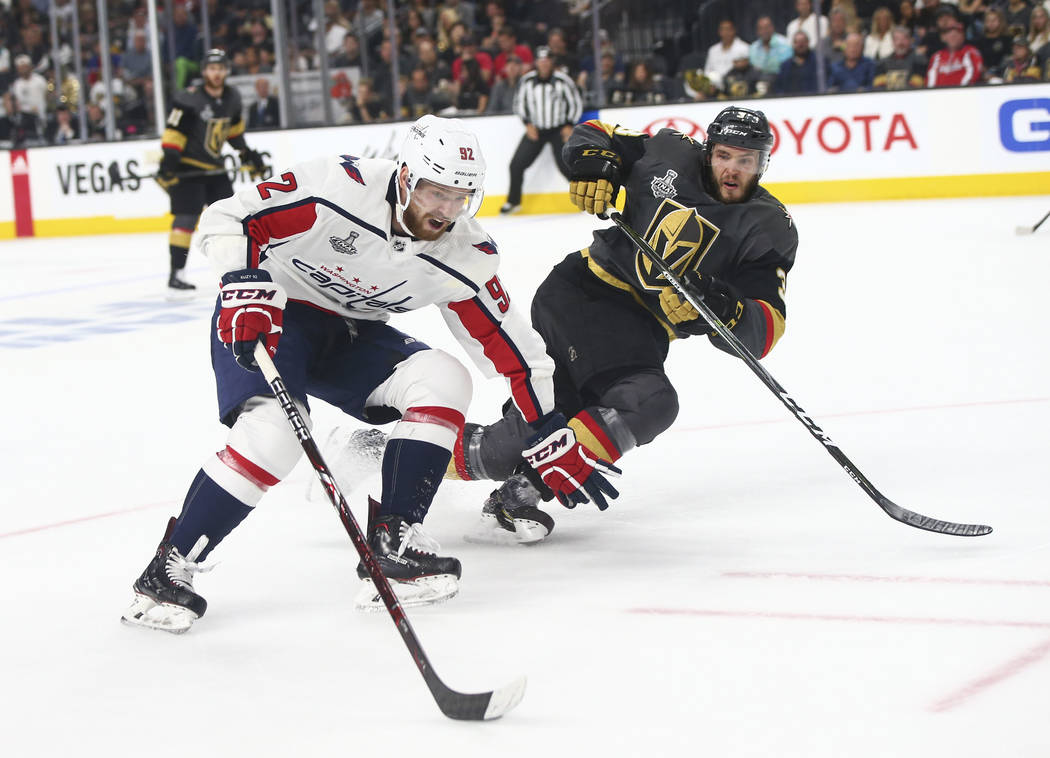 Washington Capitals center Evgeny Kuznetsov (92) moves the puck as Golden Knights defenseman Brayden McNabb (3) defends during the second period of Game 1 of the NHL hockey Stanley Cup Final at th ...