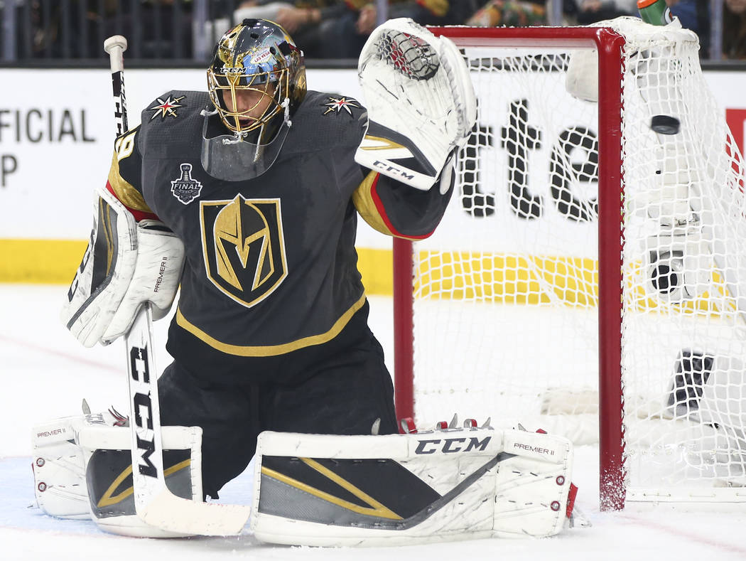 A shot goes past Golden Knights goaltender Marc-Andre Fleury (29) during the second period of Game 1 of the NHL hockey Stanley Cup Final against the Washington Capitals at the T-Mobile Arena in La ...