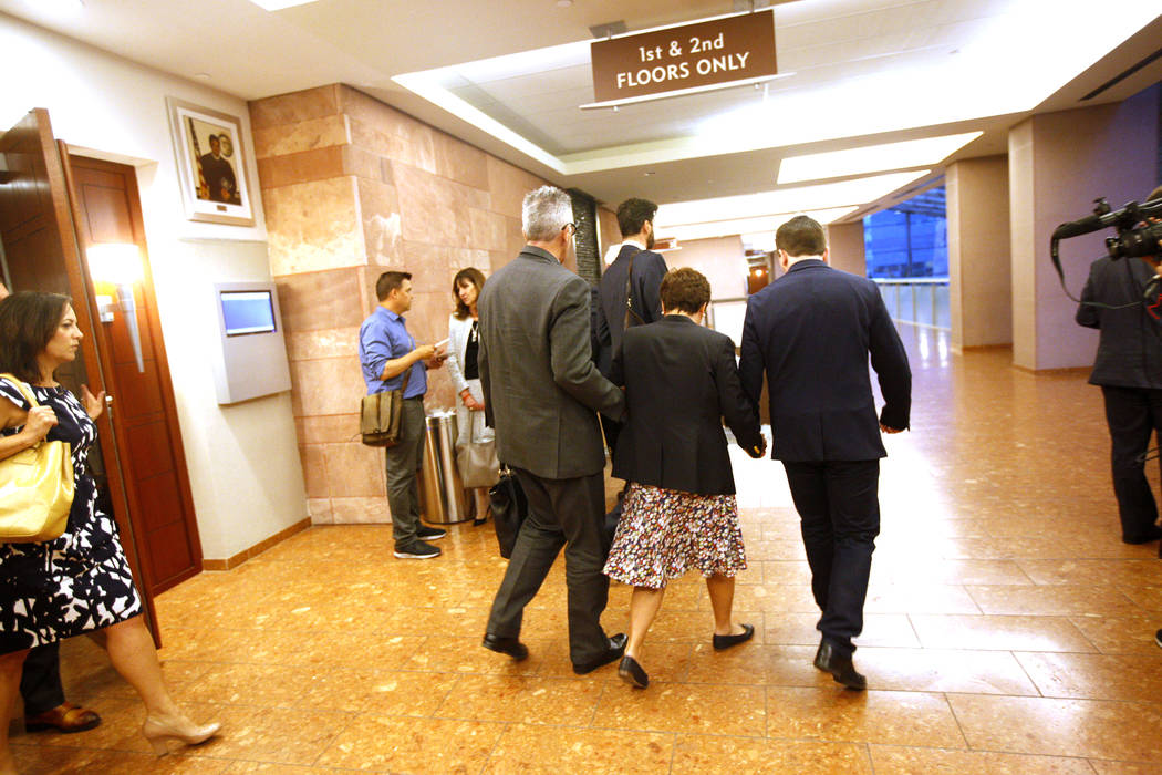 Gavin Cox leaves the courtroom with wife Minh-Han Cox at the Regional Justice Center in Las Vegas, Tuesday, May 29, 2018. Gavin Cox sued illusionist David Copperfield for injuries he sustained dur ...