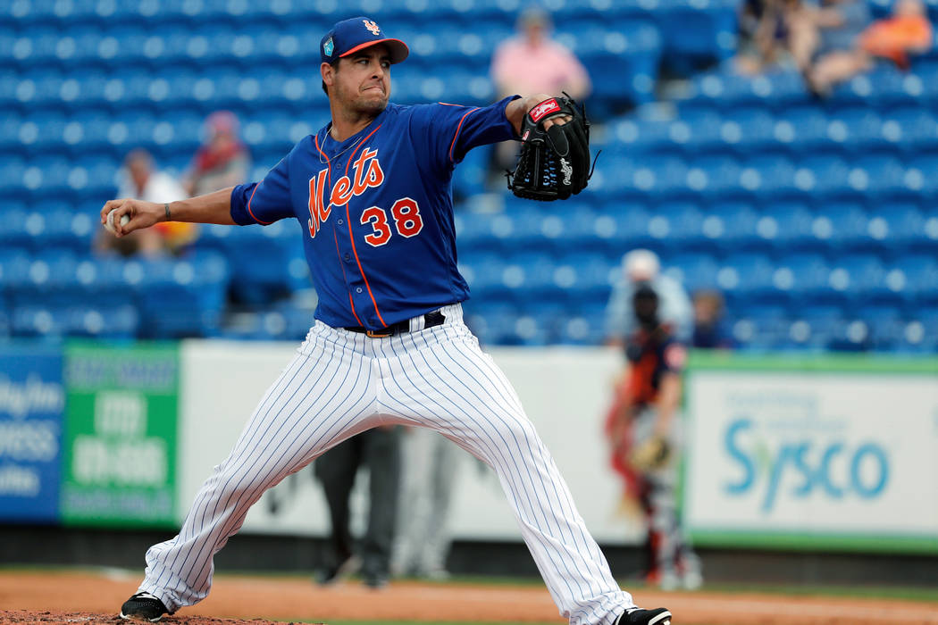 In this Feb. 27, 2018, file photo, New York Mets pitcher Anthony Swarzak throws during the third inning of a spring training baseball game against the Houston Astros in Port St. Lucie, Fla. (AP Ph ...