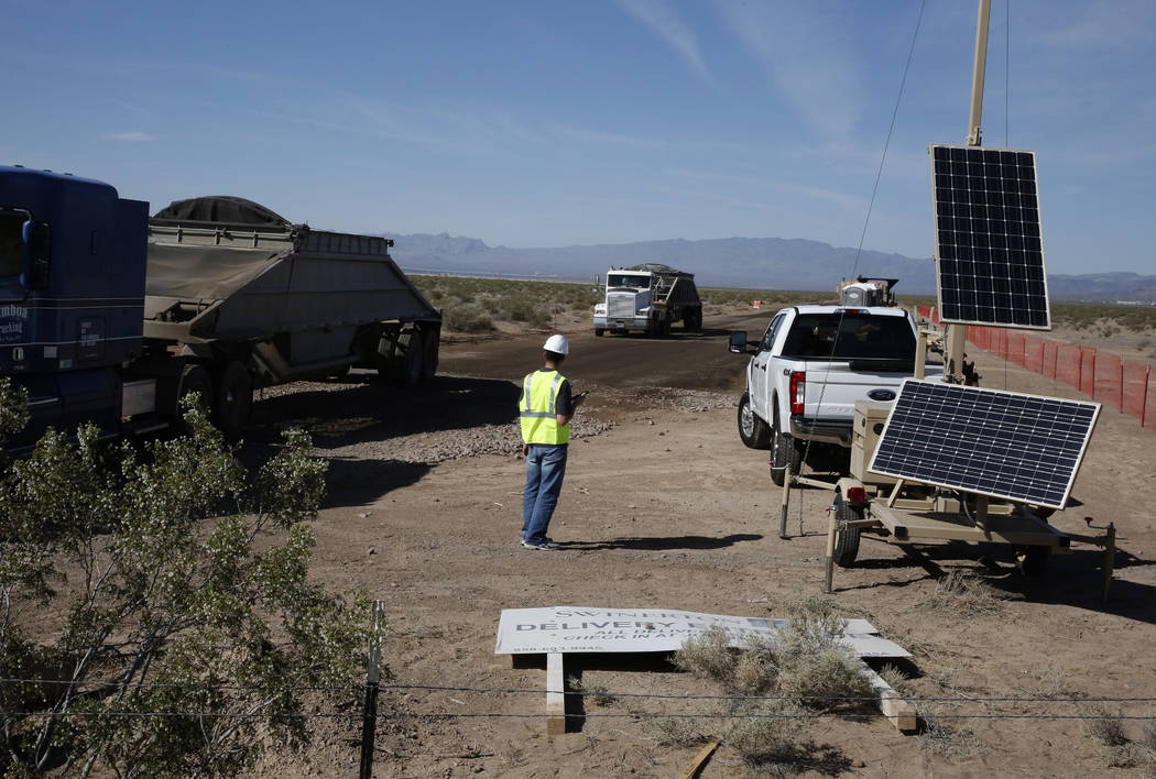 A worker directs traffic at the construction site of the El Dorado Valley solar projects on Thursday, May 31, 2018, in Boulder City. Bizuayehu Tesfaye/Las Vegas Review-Journal @bizutesfaye