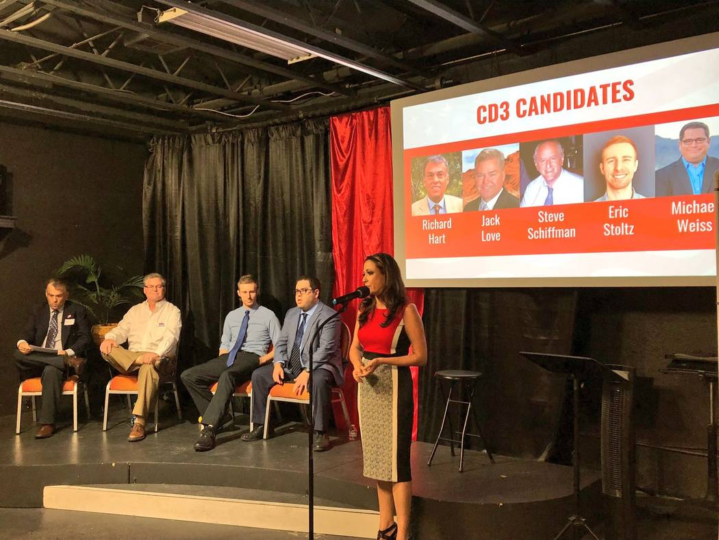 Congressional candidates Richard Hart, Jack Love, Eric Stoltz and Michael Weiss take the stage Tuesday at a candidate forum hosted by Paradise Las Vegas Indivisible at the Center for Science & Won ...