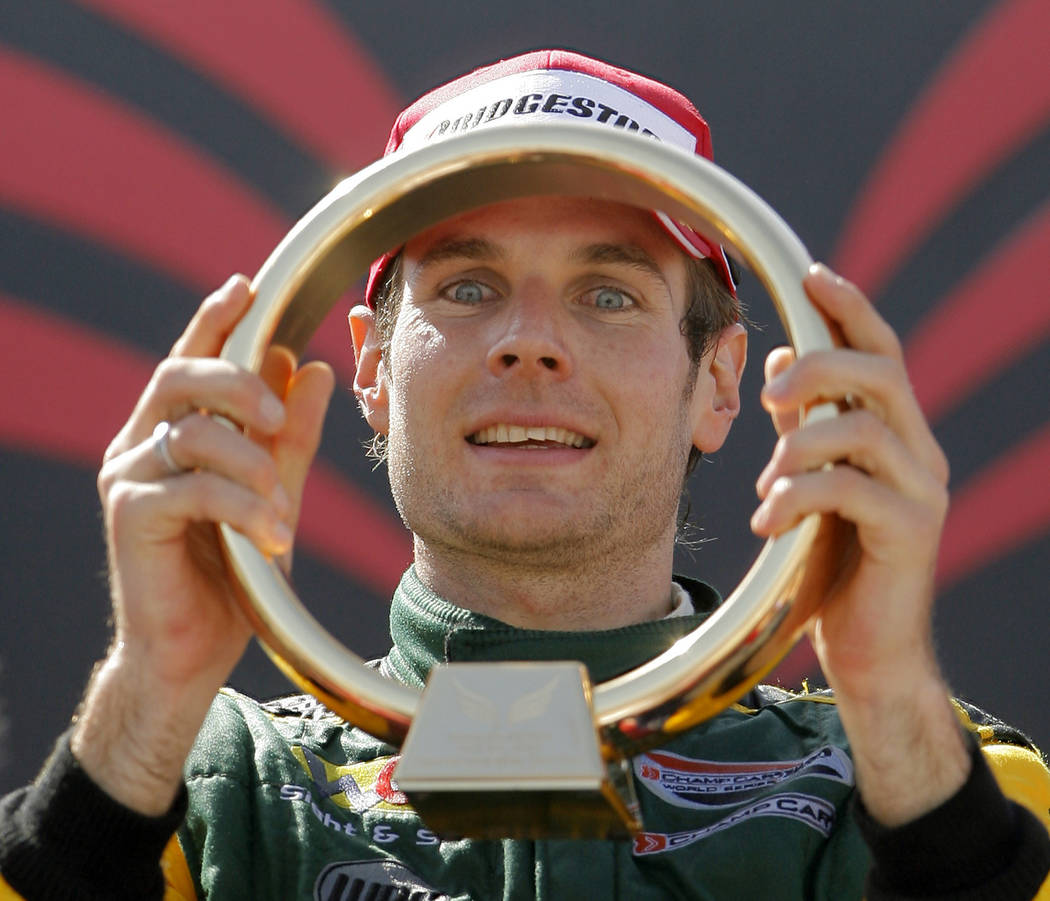 Champ Car driver Will Power, of Australia, holds a championship trophy after winning the Vegas Grand Prix auto race on Sunday, April 8, 2007, in Las Vegas. (AP Photo/Jae C. Hong)