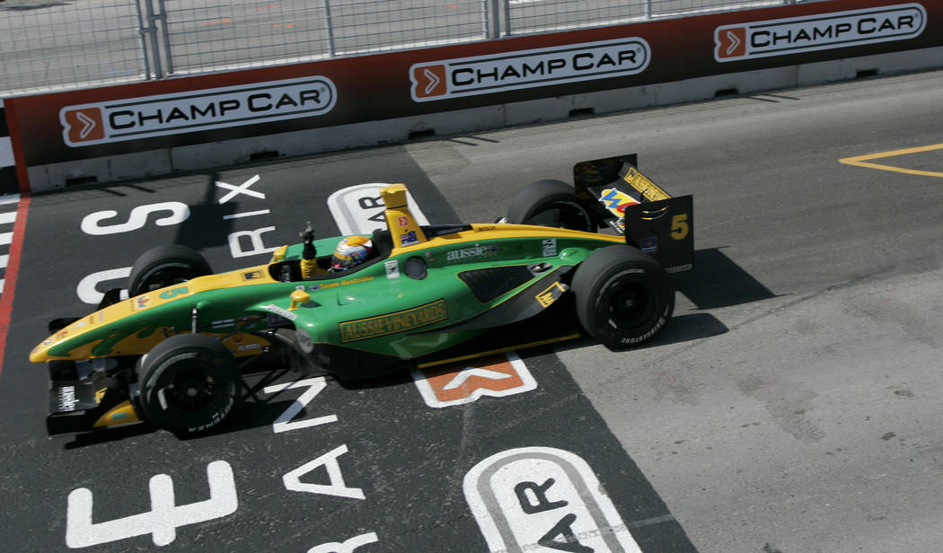 Champ Car driver Will Power, of Australia, crosses the finish line to win the Vegas Grand Prix auto race on Sunday, April 8, 2007, in Las Vegas. (AP Photo/Jae C. Hong)