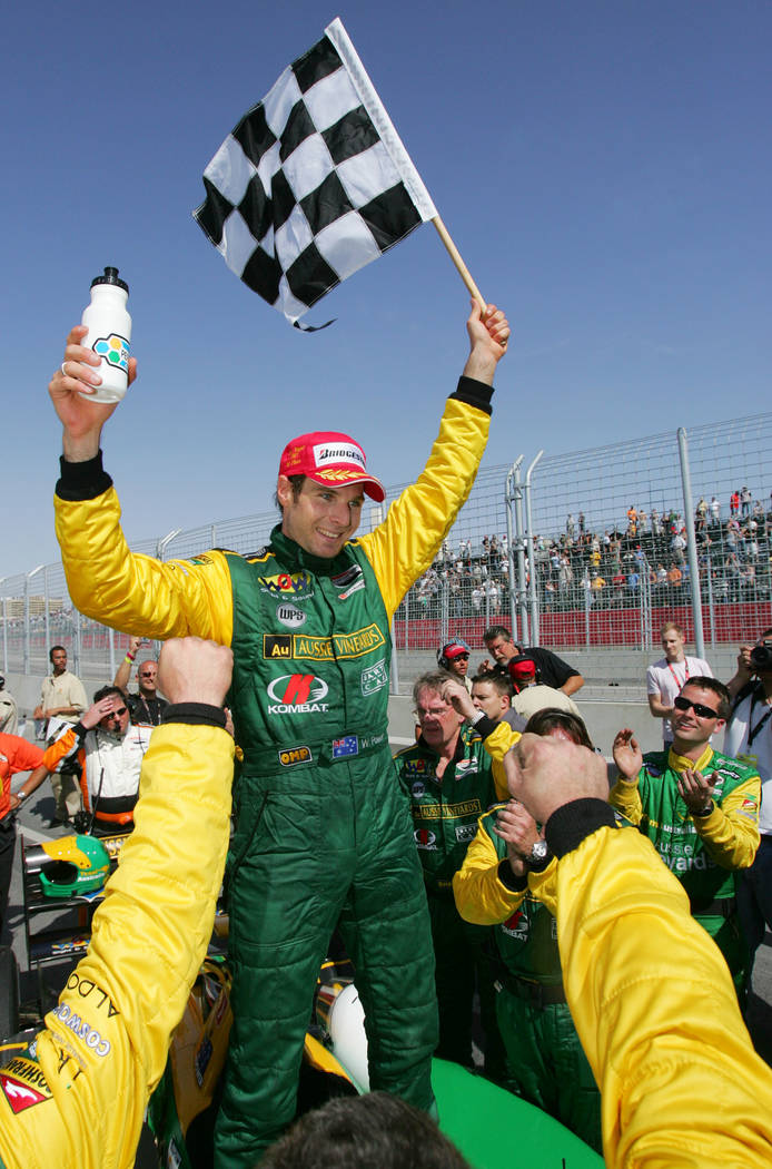 Champ Car driver Will Power celebrates his victory during the Vegas Grand Prix auto race, Sunday, April 8, 2007, in Las Vegas. (AP Photo/Eric Jamison)