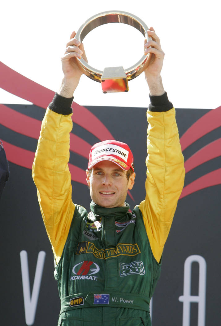 Champ Car driver Will Power, of Australia, holds the championship trophy after winning the Vegas Grand Prix auto race on Sunday, April 8, 2007, in Las Vegas. (AP Photo/Jae C. Hong)