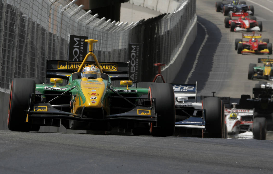 Champ Car driver Will Power, of Australia, lead a pack of cars at the start of the Vegas Grand Prix auto race on Sunday, April 8, 2007, in Las Vegas. Power won the race. (AP Photo/Jae C. Hong)