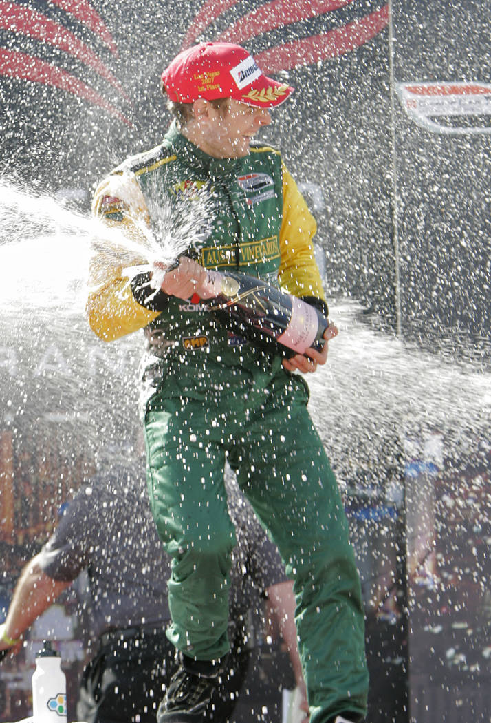 Champ Car driver Will Power, of Australia, sprays champagne as he celebrates after winning the Vegas Grand Prix auto racing on Sunday, April 8, 2007, in Las Vegas. (AP Photo/Jae C. Hong)