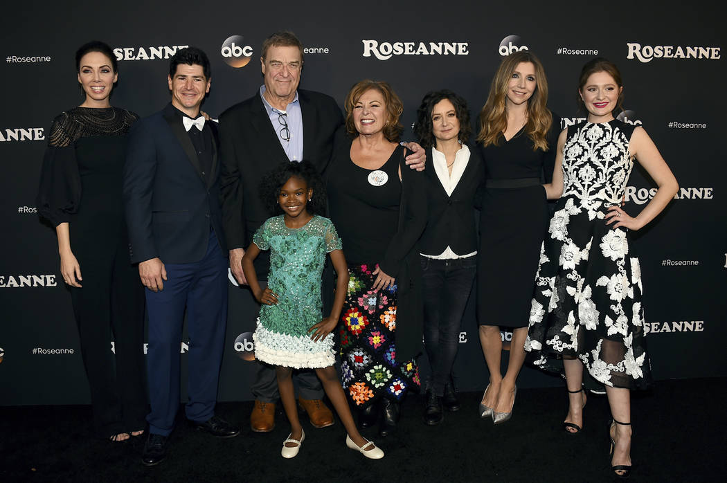 "From left, Whitney Cummings, Michael Fishman, John Goodman, Jayden Rey, Roseanne Barr, Sara Gilbert, Sarah Chalke and Emma Kenney arrive at the Los Angeles premiere of ""Roseanne"" in Burbank, Calif ..."
