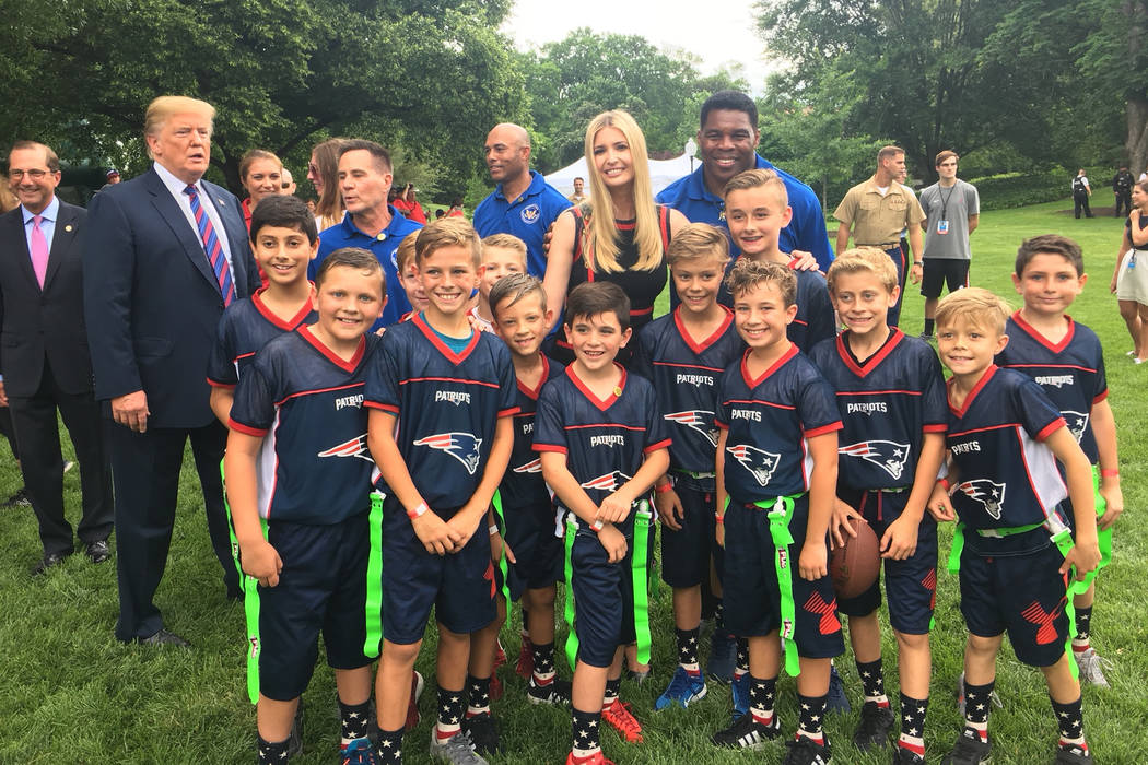 President Donald Trump, daughter and adviser Ivanka Trump and football legend Herschel Walker pose with City of Las Vegas Patriots Flag Football Team on Wednesday, May 30, 2018. Photo by Jason Ahl ...
