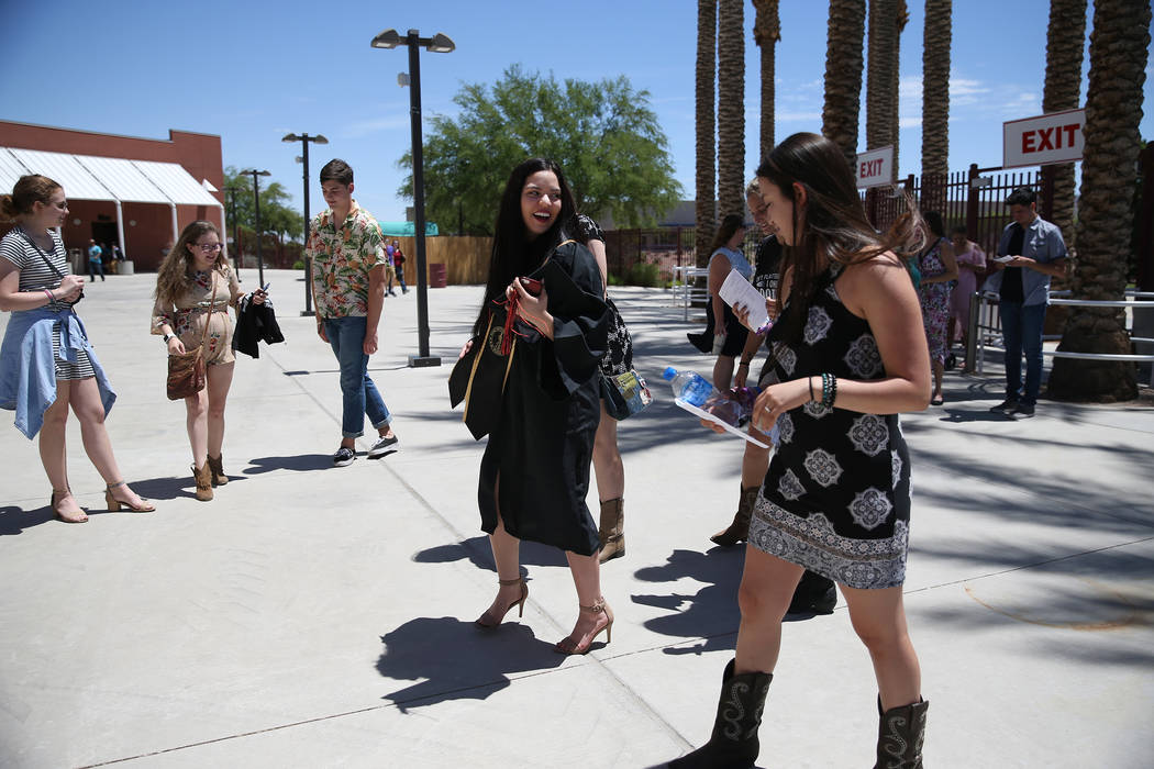 Jacquelyn Trujillo, 18, center, dances after her graduation ceremony from Nevada Virtual Academy at the Henderson Pavilion in Henderson, Thursday, May 31, 2018. Jacquelyn helped her sisters find s ...